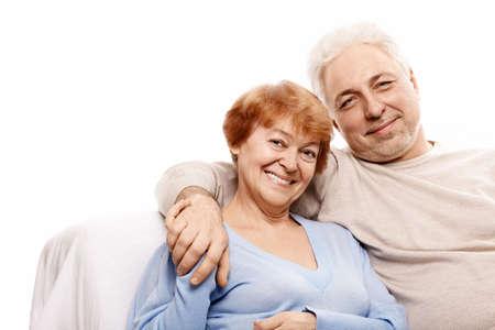 Elderly happy couple on a white background photo
