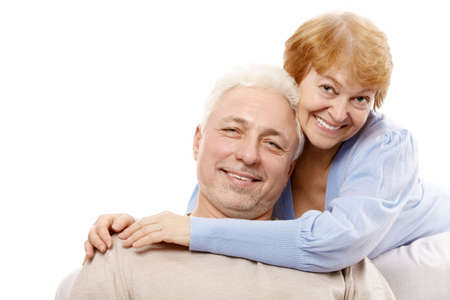 Happy spouses of advanced age on a white background  photo