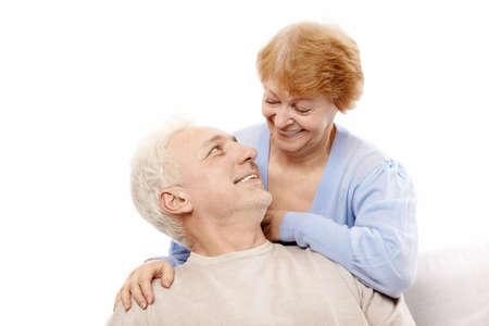 Smiling elderly couple on a white background photo