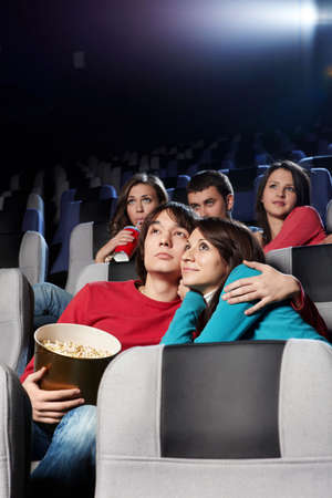 Enamoured couple at cinema in the foreground Stock Photo - 6439785