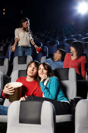 Young people look cinema at a cinema photo