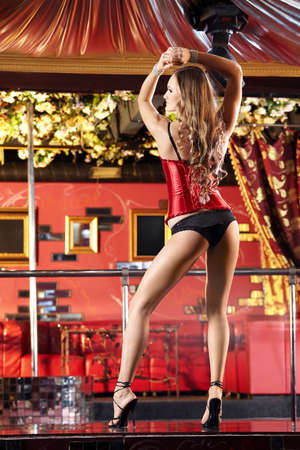 The attractive girl dances a striptease in club Stock Photo - 6439806