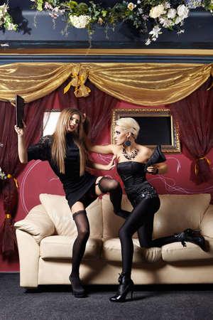 Two stylish girls fight in night club Stock Photo - 6439818