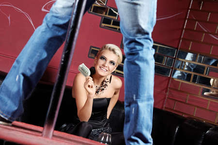 The man dances a striptease for the girl Stock Photo - 6439758