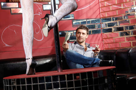 The man looks at a striptease in club Stock Photo - 6439809