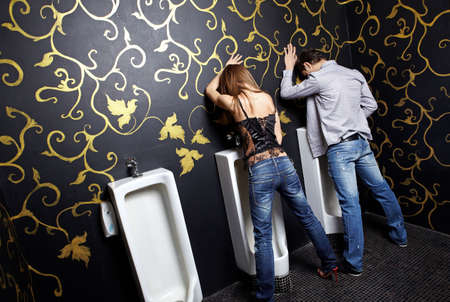 public toilet: Drunk man and the woman in a night club toilet