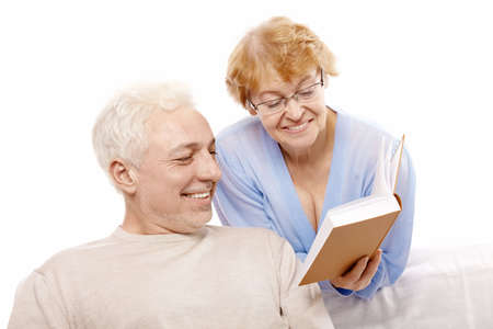 Older persons read the book on a white background  photo