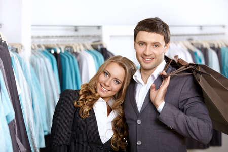 Young nice couple in shop with purchases  photo