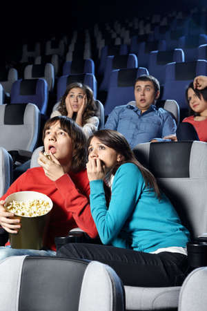 The young men frightened of viewing of cinema  photo