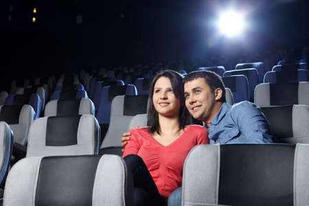 Happy enamoured at a cinema look a film photo