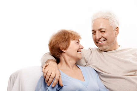 Smiling elderly pair on a white background photo