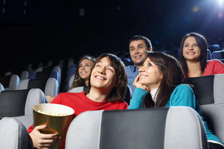 Group of young men at cinema photo