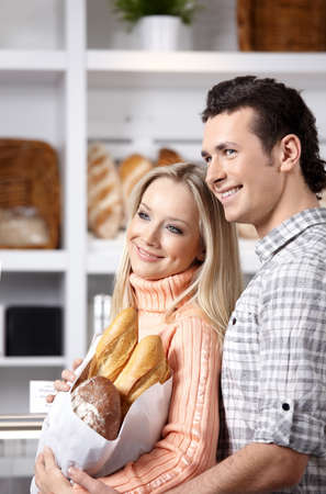 Beautiful couple with grain products on a forward background Stock Photo - 7162029