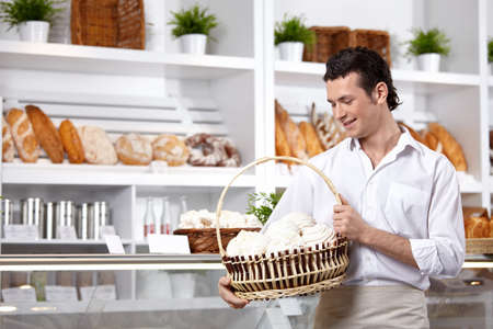 The young man with a basket of cakes Stock Photo - 7743137