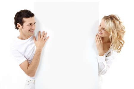 The guy and the girl exchange glances through an empty banner Stock Photo - 7743090
