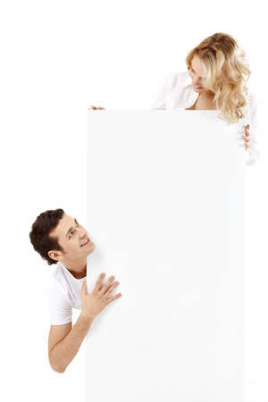 empty banner: Two young people hold an empty banner Stock Photo