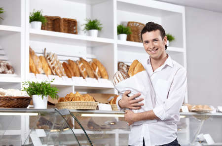 The young man with bread in shop Stock Photo - 7841373