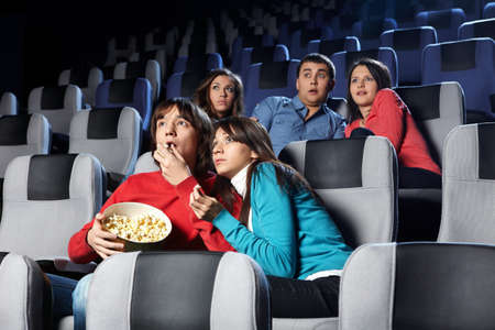 terrible: Group of young men look a terrible film at a cinema Stock Photo