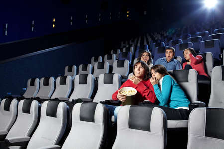 The youth looks a film at a cinema  photo
