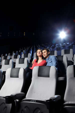 The happy enamoured couple looks cinema photo