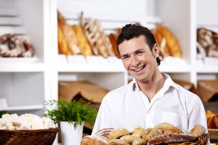 The young seller with a basket of rolls close up Stock Photo - 7841324