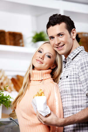 Young attractive couple with meal close up photo