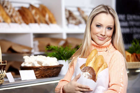 The young girl with bread in shop Stock Photo - 7841586