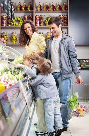 The family with children chooses products in shop  Stock Photo - 7841979