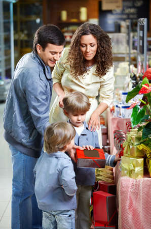 Happy family with children choose gifts photo