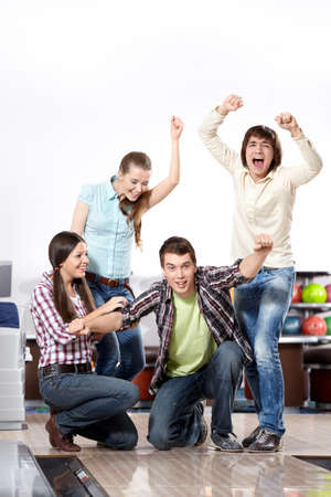 rejoice: Young people rejoice to a victory in bowling