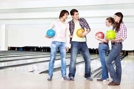 acquaintance: Two young men near to two girls