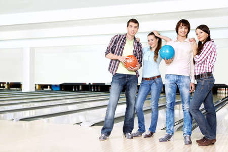 recreational sport: Young attractive people hold spheres for bowling