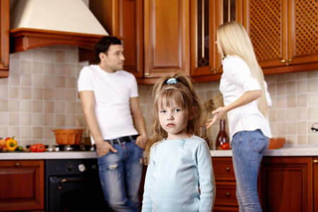 The little girl against quarrel of parents photo