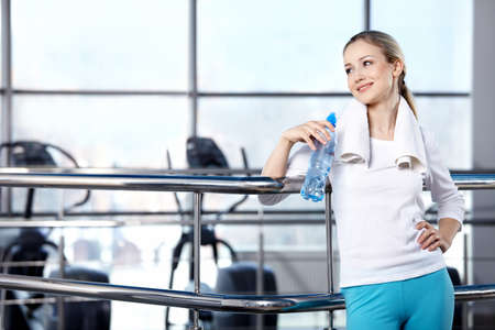 health club: Portrait of the girl in the sports form in fitness club