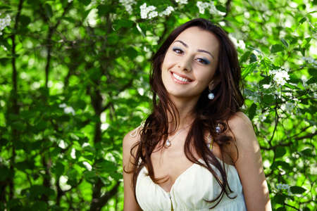 the greens: The beautiful girl in greens of trees Stock Photo