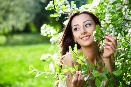 The nice young girl in blossoming trees photo
