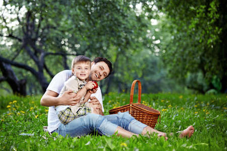 The happy daddy with the child on picnic photo
