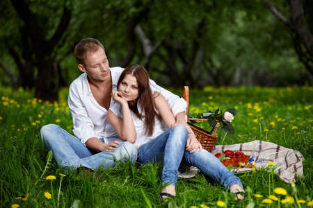 Young enamoured couple on picnic in park Stock Photo - 7931973