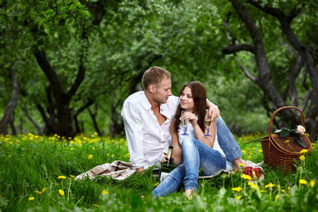 enamoured: Young enamoured couple on rest in park Stock Photo