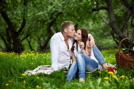 The young man kisses the girl in park Stock Photo - 7931960