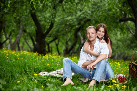 Happy young couple on picnic in park photo