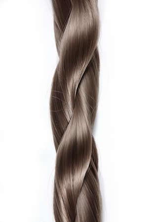tinte de cabello: Trenza gruesa de pelo sobre un fondo blanco  Foto de archivo
