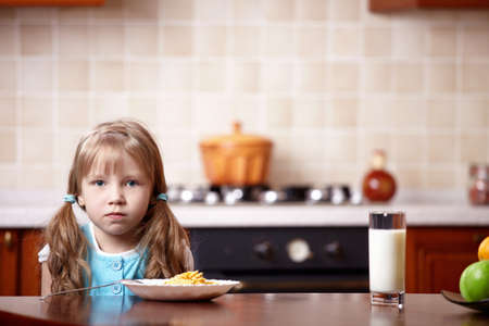 Portrait of the little girl on kitchen photo