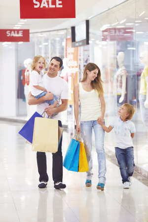 Family with two children in the store photo