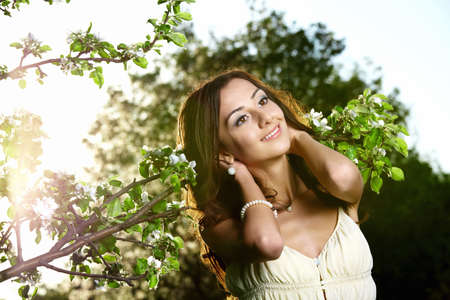 The attractive young girl against trees photo