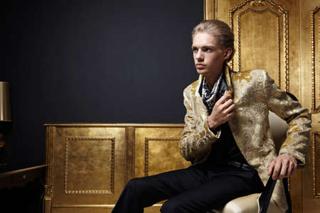 The young man in a gold jacket photo