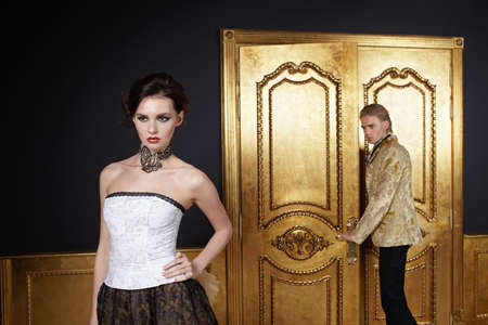 The beautiful girl and the young man in a gold interior photo