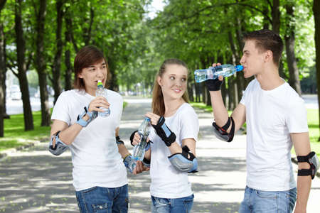 Young people in equipment in park drink water Stock Photo - 7952630