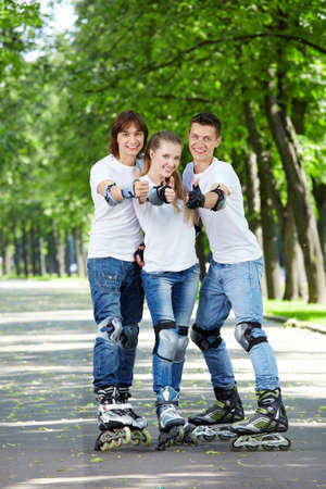 Three young people on the rolls show a big thumbs up Stock Photo - 7994812