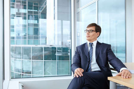 ceo: A man in a business suit at the office